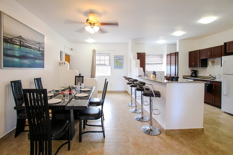 Bright and modern kitchen and dining area with breakfast bar