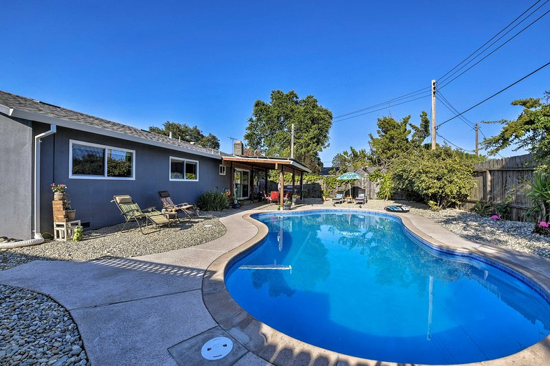This impressive vacation rental property includes a private yard, pool, & patio.