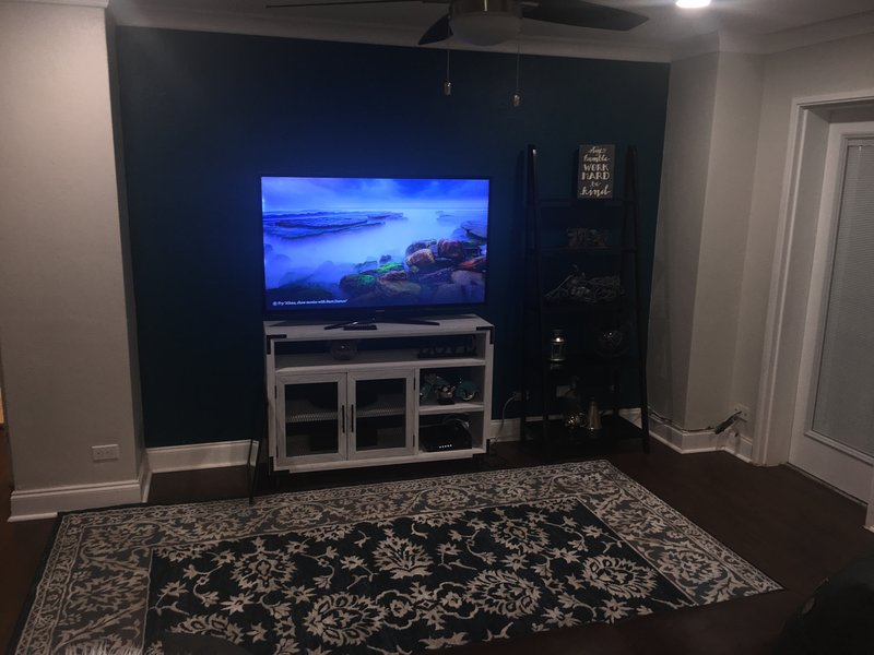 55 inch flat screen TV in spacious family room