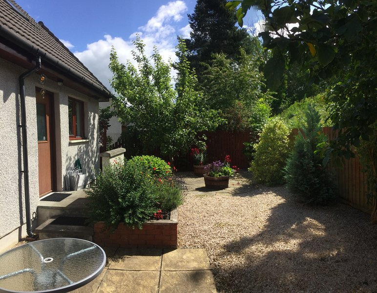 Enclosed back garden - with patio, table and chairs