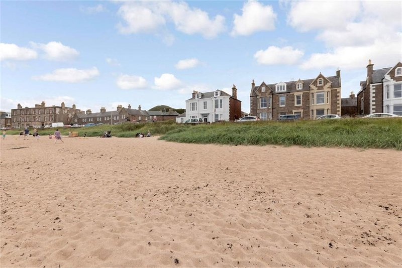 Beachfront ground floor flat is directly across the road from an absolutely beautiful beach.