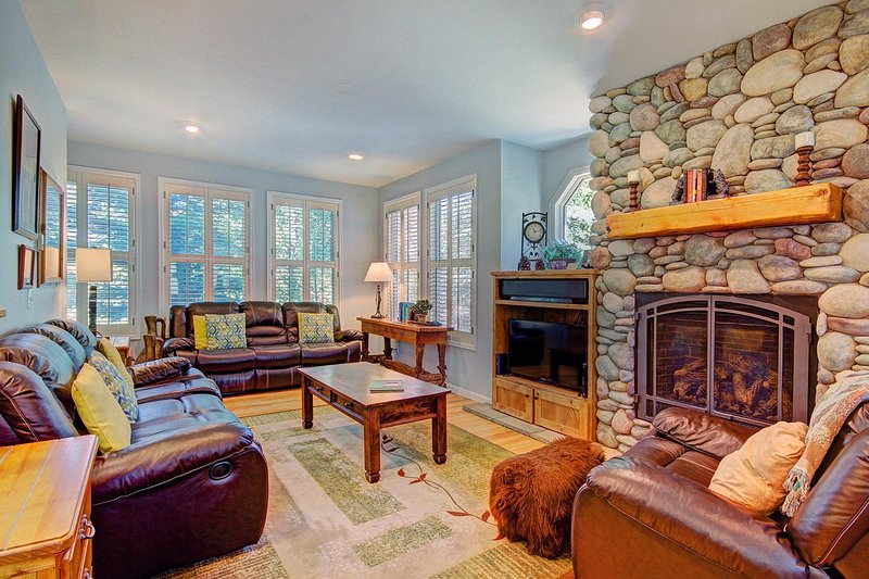 Stay warm and cozy by the elegant gas fireplace