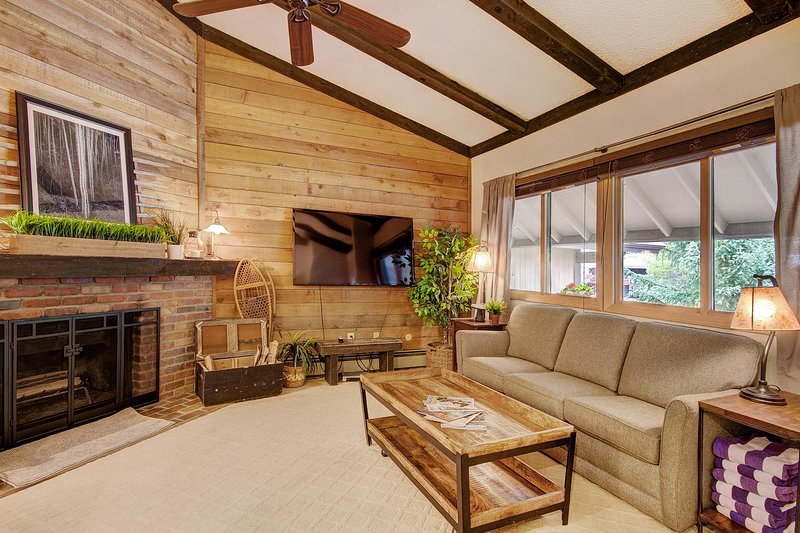 Cozy living room with gas fireplace and flat screen TV