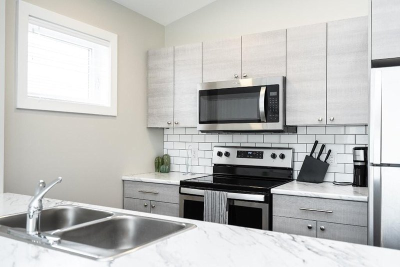 AMAZING! - is what you'll be saying when you come into this unit.  Completely open concept, private balcony, and entrance!    The location cannot get much better than this.  Less than 5 minutes from downtown, walking distance to many great local re...