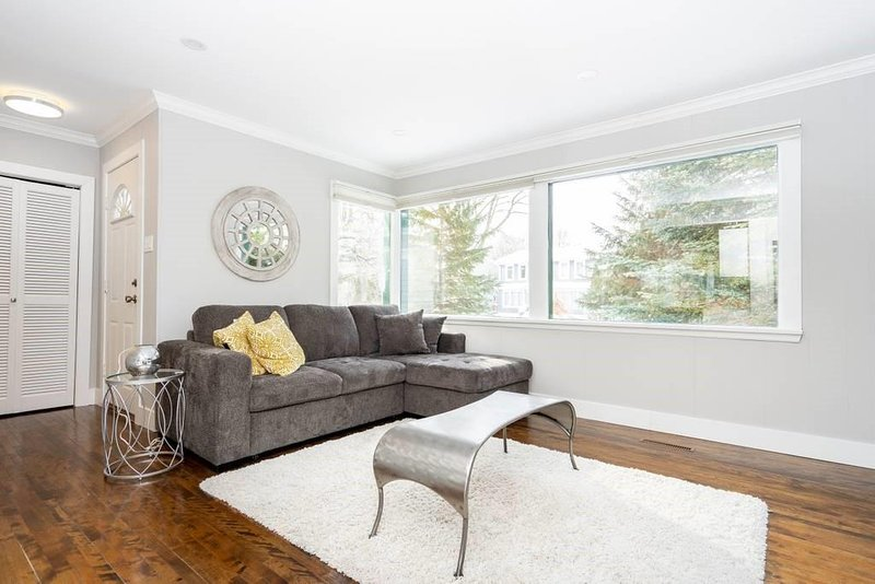Looking for a home away from home?  You found it!   This 980 square foot Bungalow has a distinctive coziness!  Nestled in one of Winnipeg's most loved neighbourhoods, surrounded by mature trees,  parks and walking paths.   The electric fireplace k...