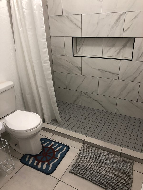 Full bathroom with room for all of your beach needs
