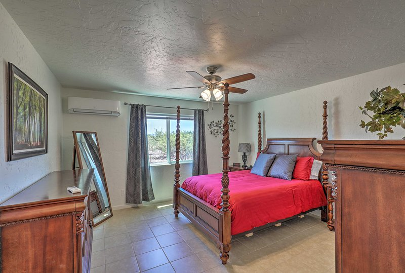 This bedroom is complete with a queen-sized bed, ideal for couples.