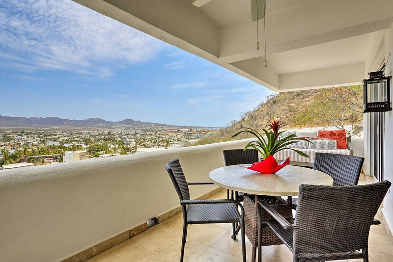 Take in the views of the mountains and city from the balcony.