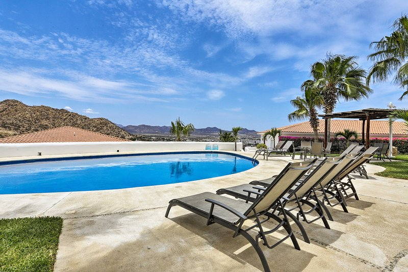 Lounge by the community pool at this 2-bedroom, 2-bath Cabo San Lucas condo!