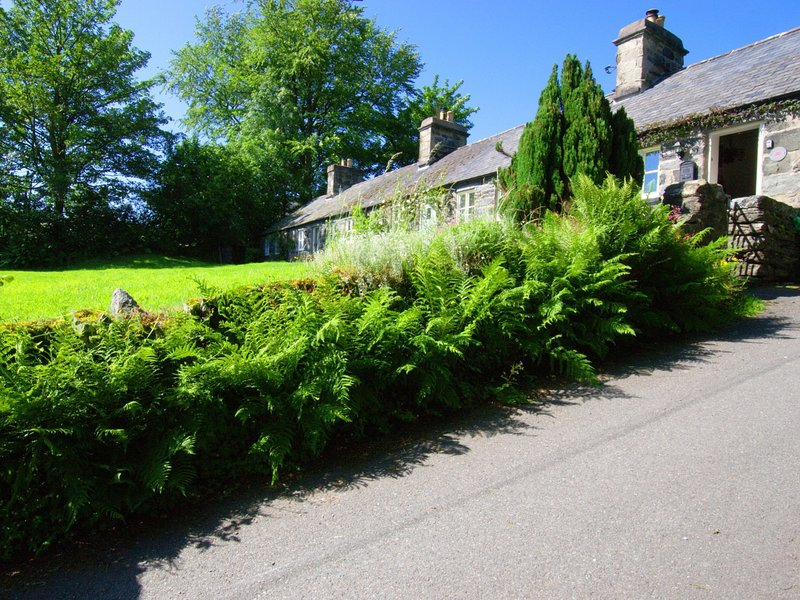 The cottage is perched on a hill with views over the village