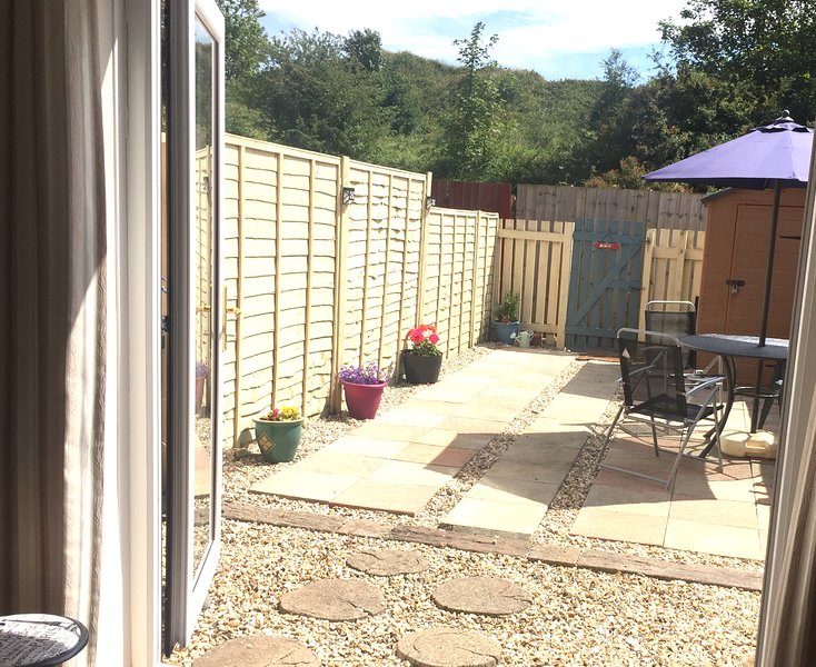sunny back garden . Fenced . gate to dunes