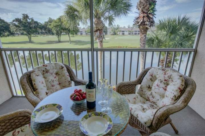 Screened balcony off the living room.  Enjoy the golf course and water views.