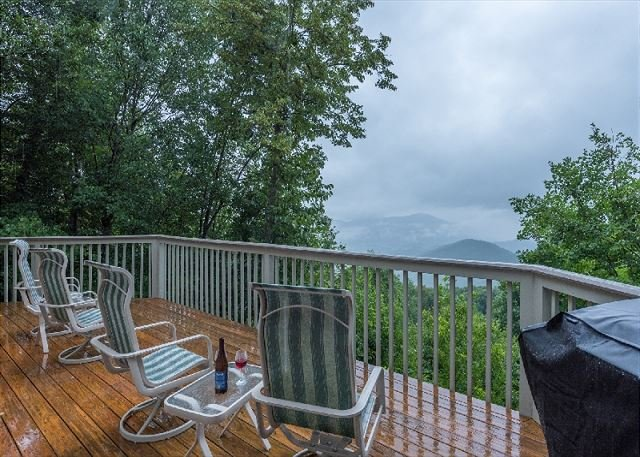 Large upper level deck with long range views: