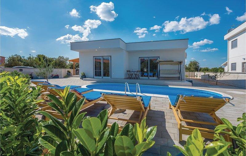 Beautiful home in Sibenik with Outdoor swimming pool, WiFi and 4 Bedrooms (CDJ62, holiday rental in Jadrija
