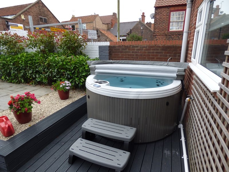 The hot tub, with the cover..