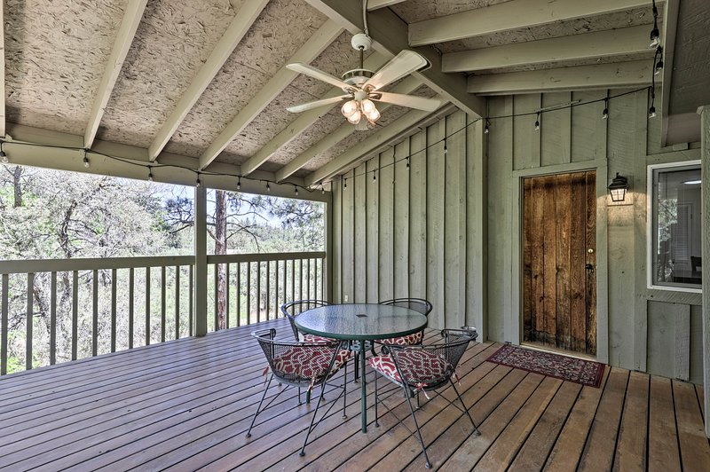 The covered deck looks out over the forest.