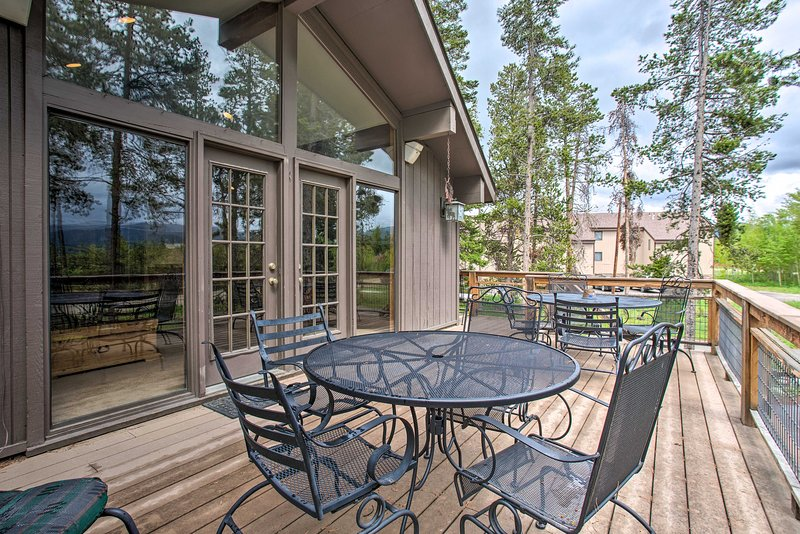 This home boasts a beautiful deck with outdoor seating!