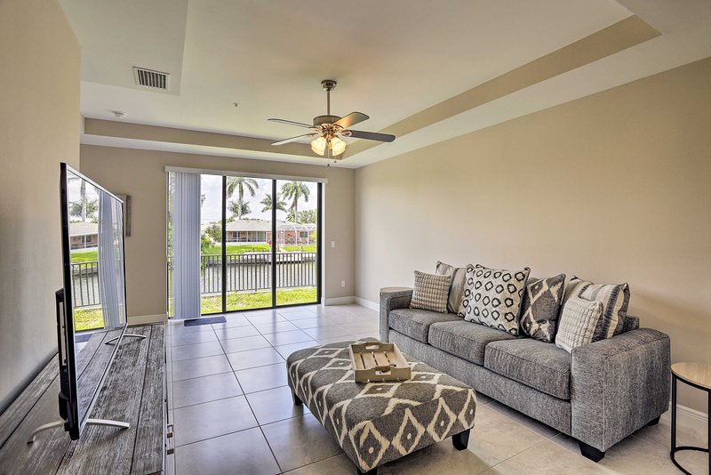 Stay beside a canal at this 3-bed, 2.5-bath Cape Coral condo getaway for 6!