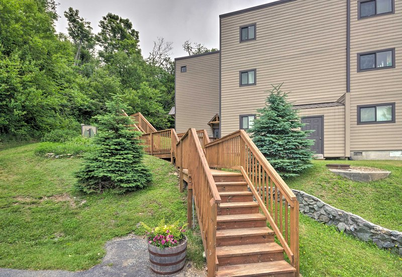 Head up the stairs to the front door of the condo!