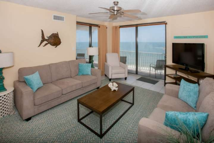 Living room w/seating for 6, a 55' TV and access to the Gulf-front balcony