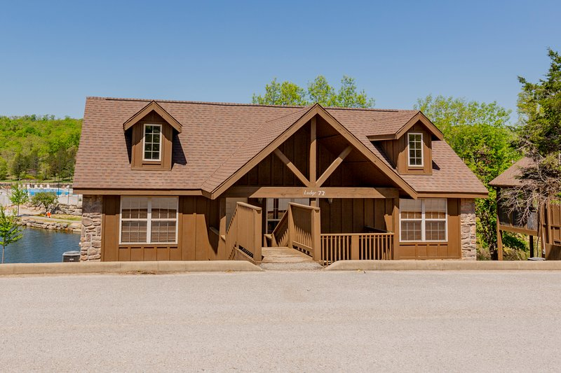 Repainted 2-Br Lodge right on the shore of Fox Hollow Lake. Great Fishing!