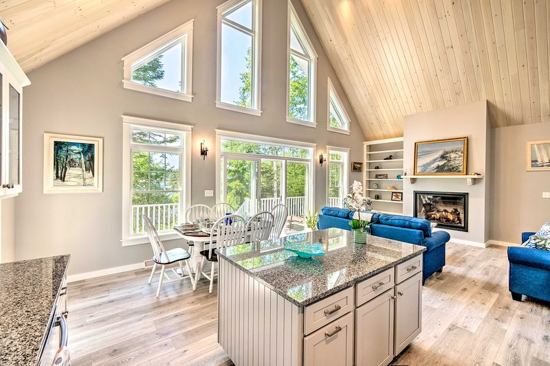 The interior features coastal decor and high-end furnishings.
