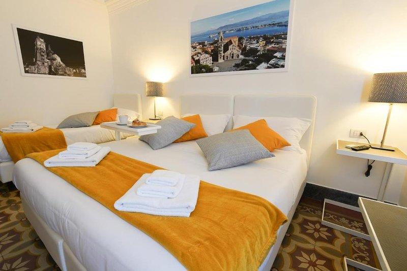 Le Stanze di Piazza Cairoli - Camera Tripla Luxury, holiday rental in San Filippo del Mela