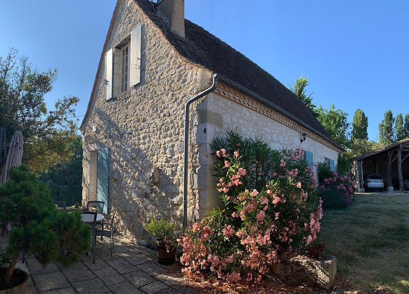 View of the cottage and its patio beside it