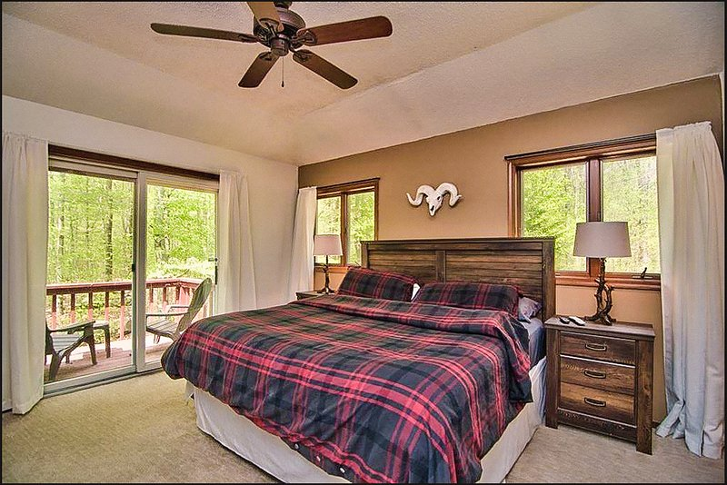 Master Suite with private balcony. Enjoy morning coffee watching birds fly!