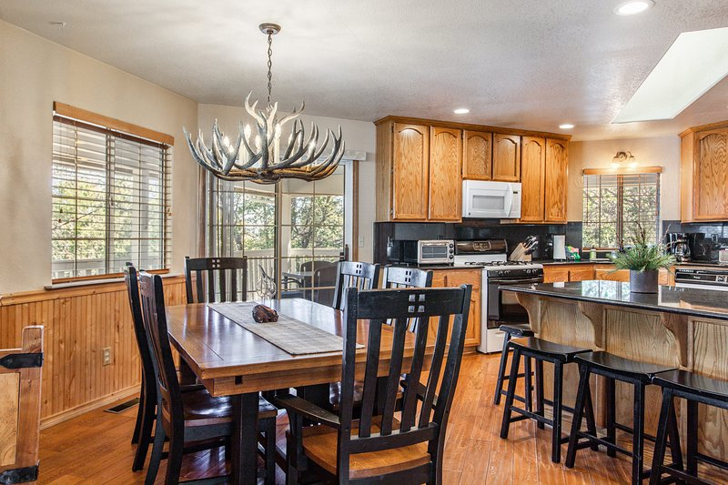 The dining area flows effortlessly into the kitchen.