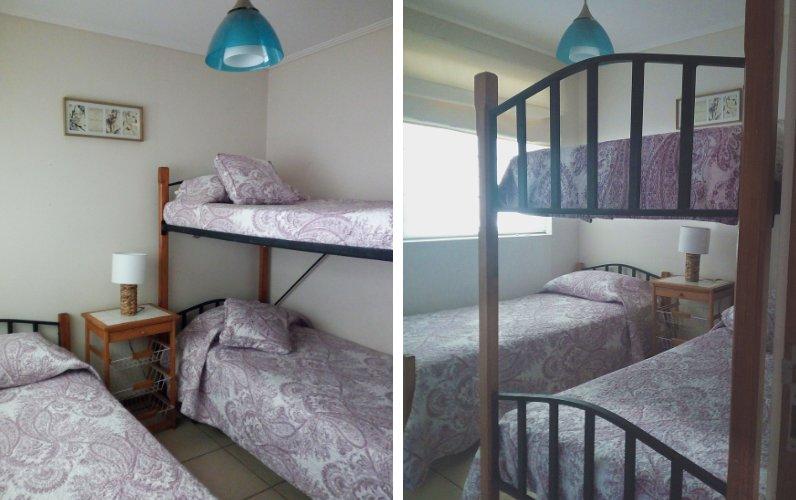 Dormitorio con literas y cama individual, con armario empotrado, la ventana da a la sala de áreas comunes