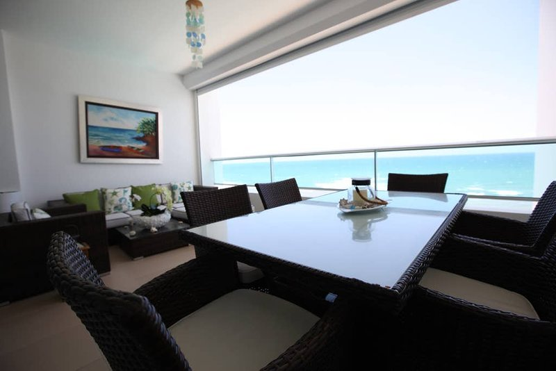 -LIMITED TIME OFFER-: FREE weekly cleaning (applies for renters of 7 nights +)   7th  Floor at Marbella, Juan Dolio. Beachfront apartment.   120 m^2   2 Infinity Pools + Jacuzzi. Onsite, secured, gated, garaged parking. Walking distance to Do...