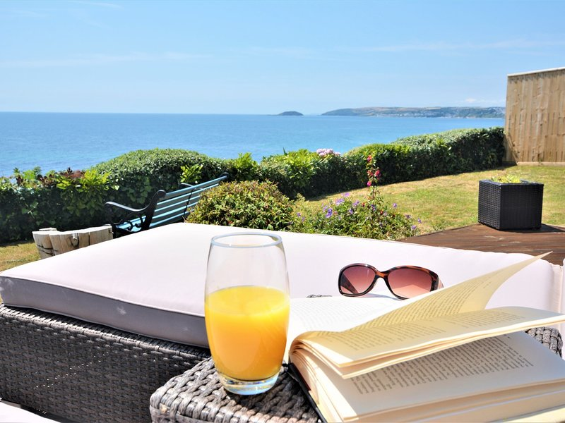 Have a lazy day basking on the sun loungers over looking the sea