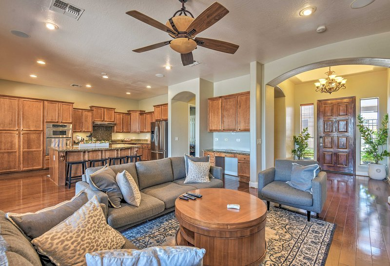 Book a trip to this 5-bedroom, 2.5-bathroom vacation rental home in Goodyear.