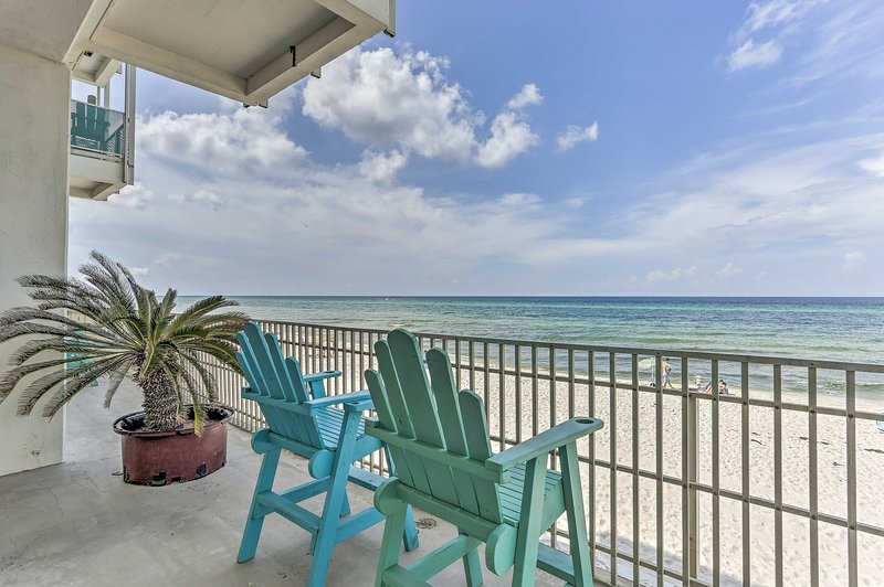 Sip on a drink in front of the beach at this Panama City Beach studio!