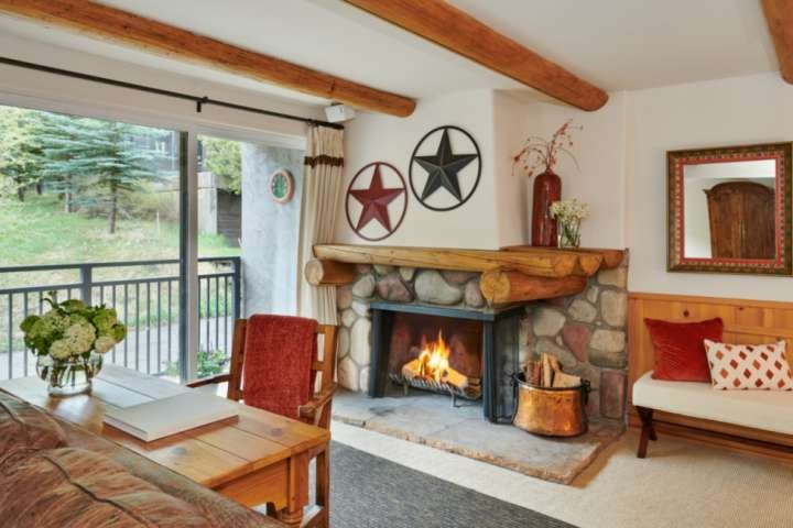 The wood burning fireplace adds even more warmth to this already welcoming living room.