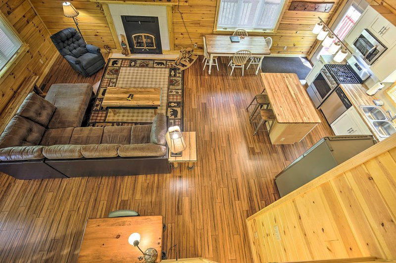 Book a trip to this cozy 4-bedroom, 3-bath vacation rental cabin for 12.