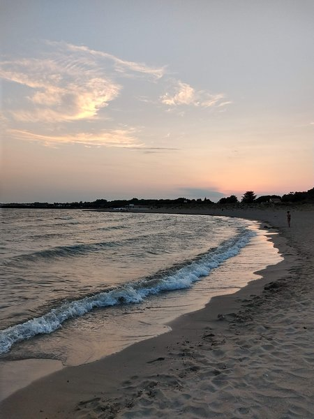 We love a sunset stroll on Vias Beach!