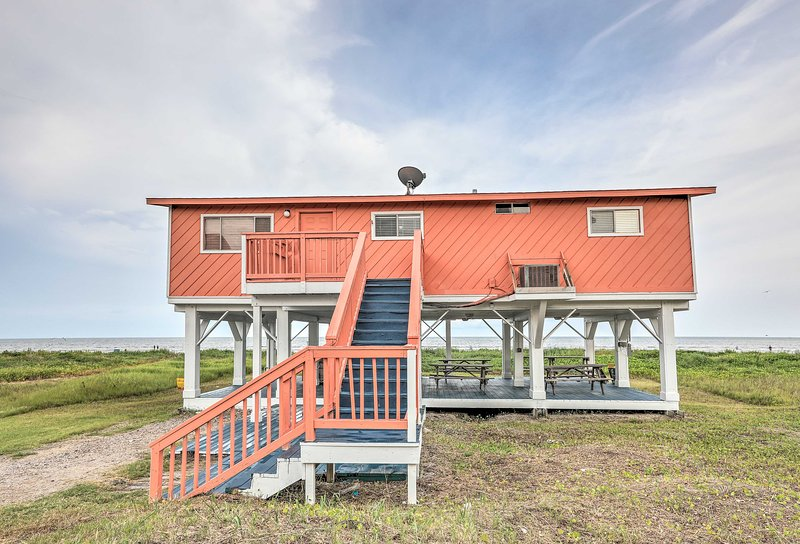 The beach is calling up to 12 of you to stay at this seaside home in Galveston!