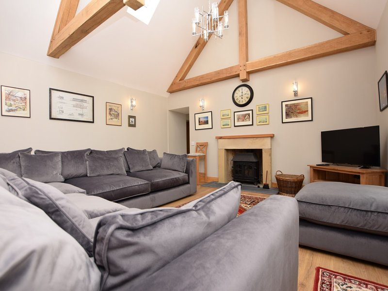 Stylish lounge with wonderful vaulted ceilings and exposed wooden beams