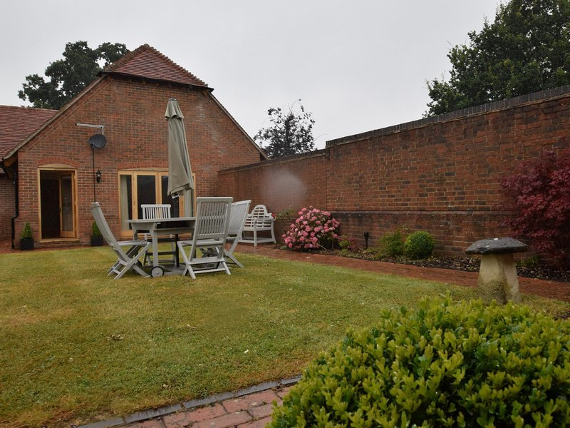 Even in the rain the garden looks like the inviting outdoor area as is intended