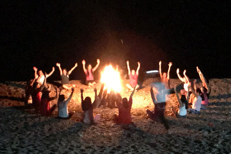 Team building while enjoying a bonfire on the private beach.