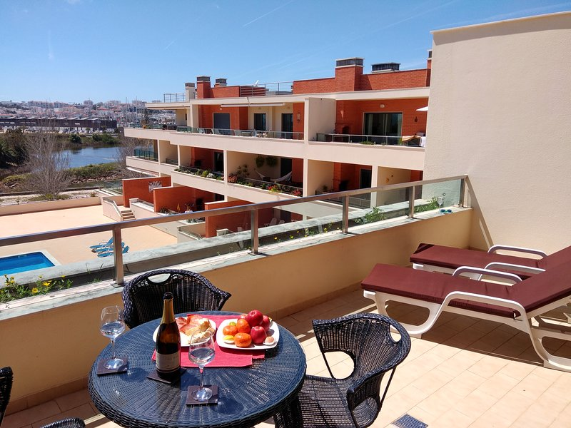 Top floor sun terrace with swimming pool for complex