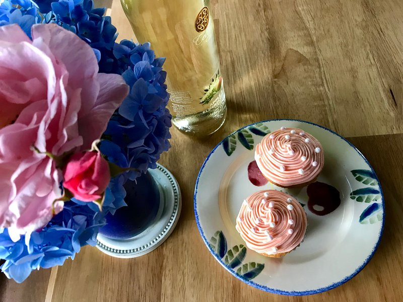 Flowers from the garden, wine and handmade cupcakes.