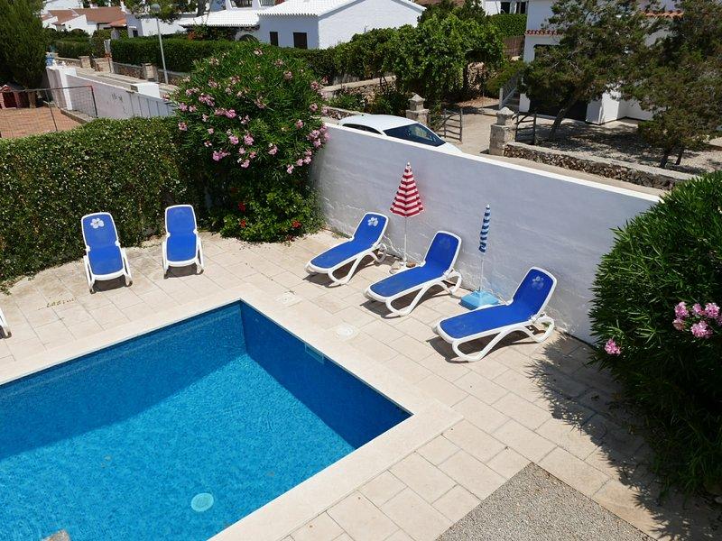 Pool area with sunbeds