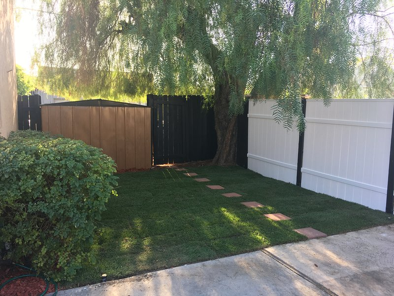 this is your fenced grass backyard.