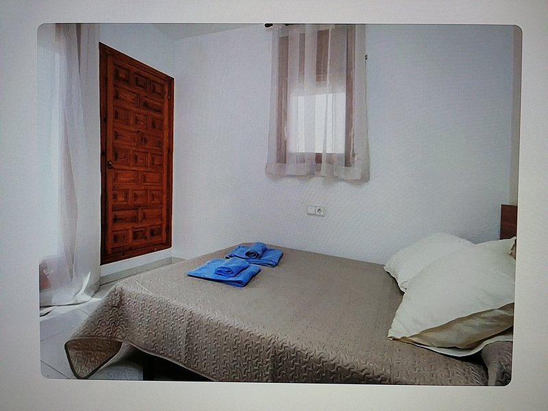 Upper floor room, with terrace and double bed, built-in wardrobe.