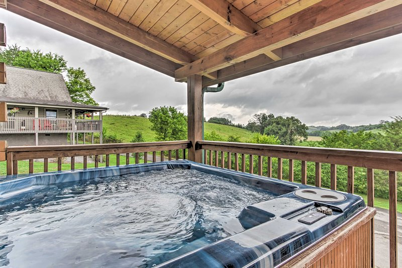 This vacation rental cabin features a furnished deck, private hot tub and more!