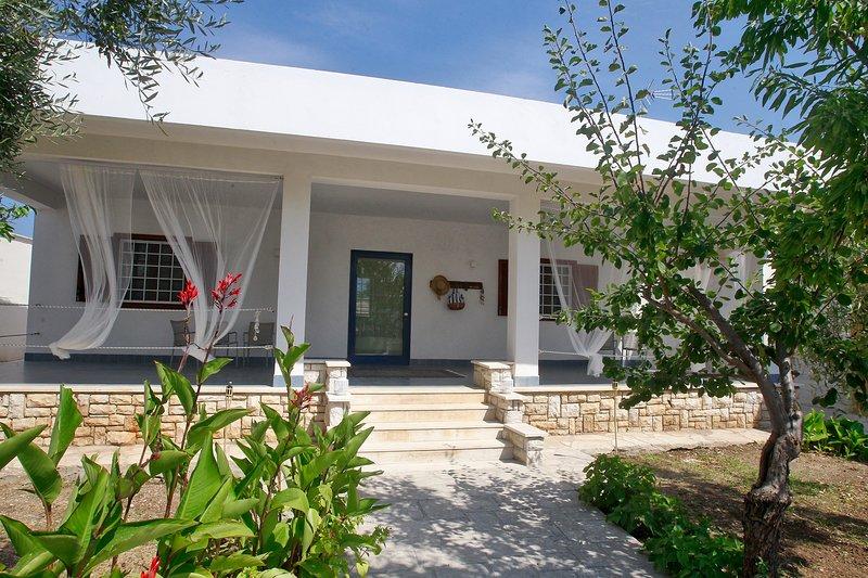 Villa entrance with patio