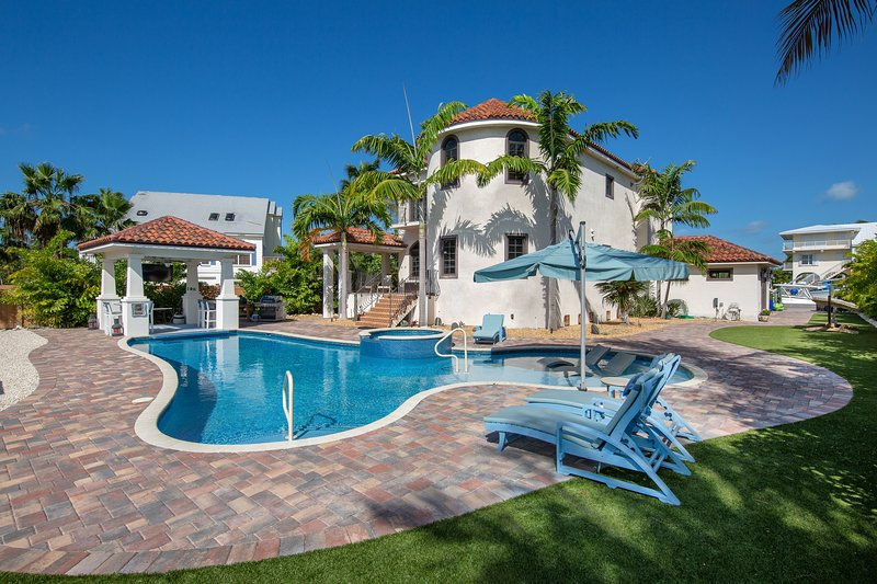 Elegant, waterfront home w/ private pools, firepit, & dock - walk to beach, vacation rental in Marathon Shores